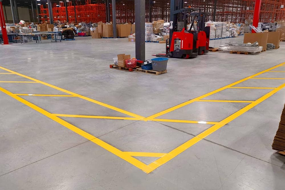Line painted safety walkway in warehouse